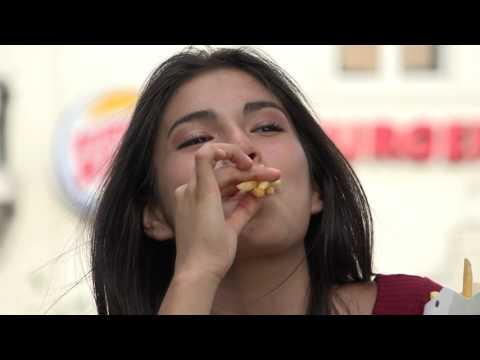 Teen Girl Eating Junk Food