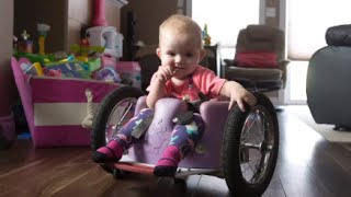 Baby Cruises in Homemade Wheelchair