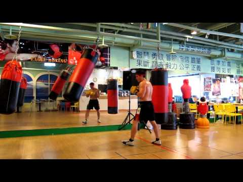 Burro on heavy bag @ Eagle Boxing Gym Taipei 2012.10.06