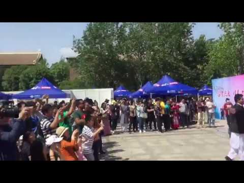 Pakistan students singing in tianjin university china culture festival