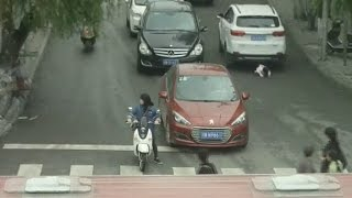 toddler-in-china-survives-being-run-over-by-2-suvs-in-viral-video