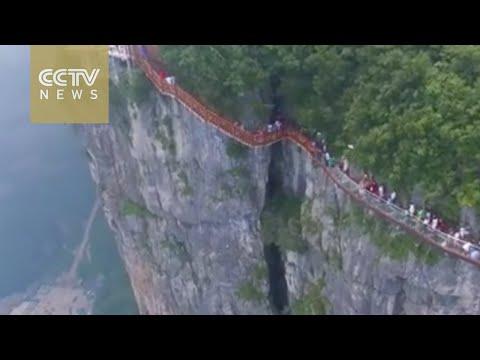 Spectacular aerial view of glass-bottomed walkway at Hunan's Zhangjiajie