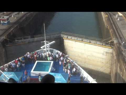 Panama Canal Lock Filling Up to Lift Cruise Ship and Gates Opening