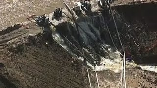 Raw: Water Flows Over Texas Dam