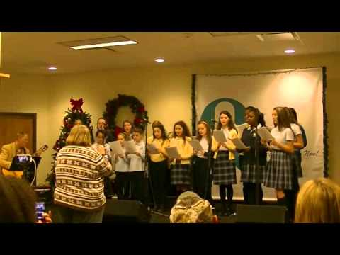 Kingston Catholic School Choir performs for Joe Daily's Holiday