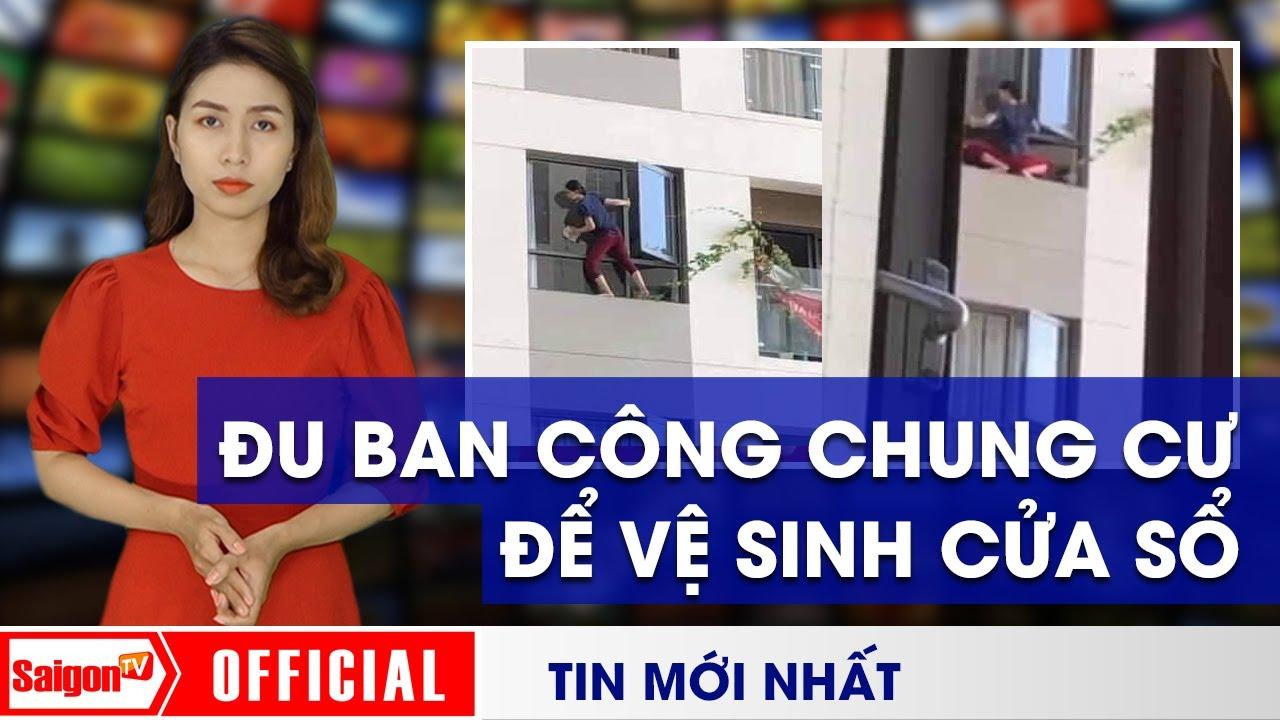 image Thót tim với cảnh 'NỮ NGƯỜI NHỆN' đu ban công chung cư để LAU CỬA SỔ