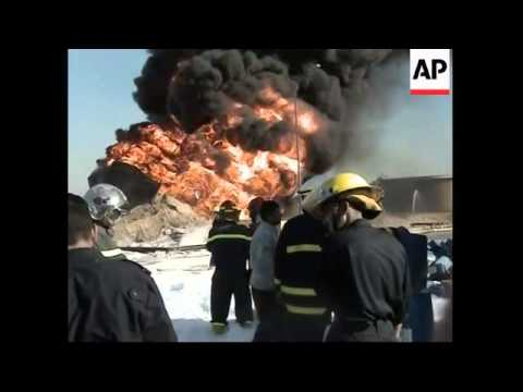 Fire rages at oil refinery, suspected industrial accident