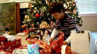 Daniel unwrapping his Christmas presents