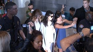 Kim Kardashian Gets Police Escort With Khloe At LAX, Asked About Making $43.4 Million On App  [2014]