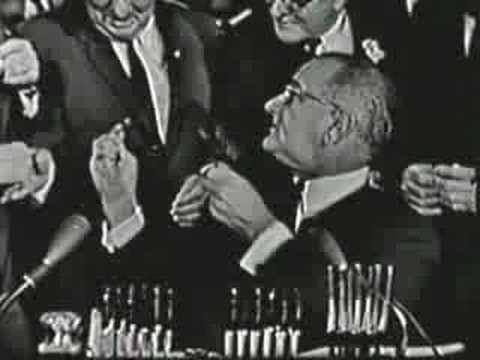 President Johnson signs 1964 Civil Rights Bill