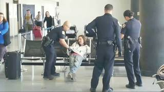 Lax airport police  on a 390 man at Los Angeles International Airport