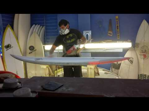 Surfboard sanding by Swell Surfboards...