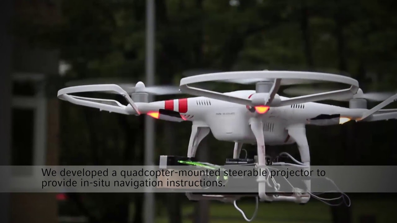 Quadcopter-Projected In-Situ Navigation Cues for Improved
