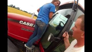 beautiful girl cleaning case ih 305 magnum tractor windows unloading grain cart wheat