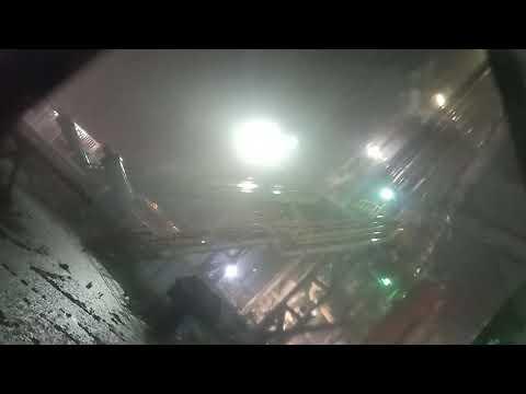 Oil drilling site under heavy rain