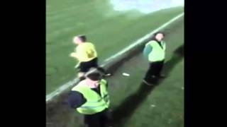 Fans throw a bucket of water to a referee!