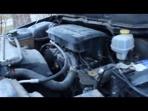 What causes a tapping noise in the engine of a minivan?