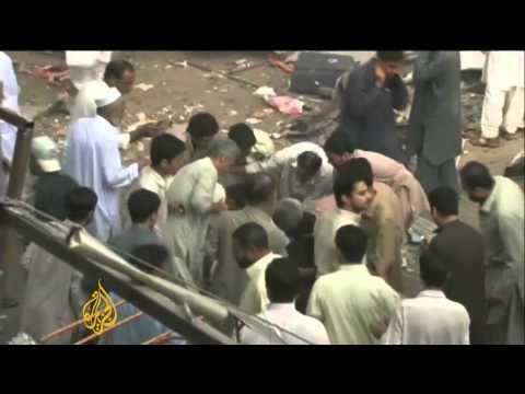 Blast Kills Dozens In Pakistan's Peshawar