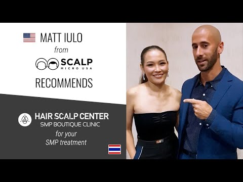 Nisa From Hair Scalp Center And Matt From Scalp Micro USA At The World SMP Awards 2019 In Orlando.
