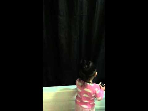 Baby Isay cleaning the bath tub using mommy's eye glass cloth