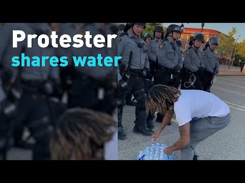 See Protesters Donating Water To Police And Thanking Them