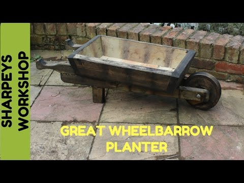 Wheelbarrow Planter From Recycled Wood And Pallets