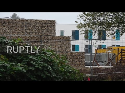 germany wall built around empty refugee centre due to preemptive noise complaints