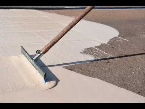Road surfacing squeegee spreading resin
