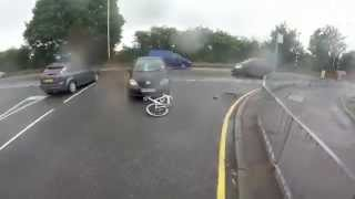 Bike rider gets hit by a car and manages to land on his feet
