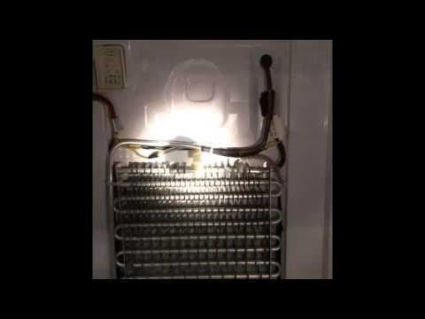 Repair to Samsung Refrigerator with ice and water accumulation under crisper drawer