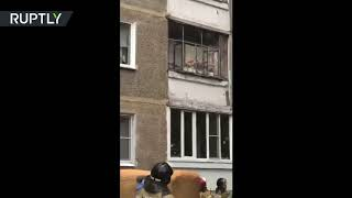 Russian Police Prevents Father From Throwing His Baby Out Of The Window