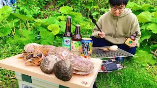山の中、独りで貝とビールを貪りたかった。
