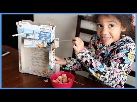 Watch Her Make A Rube Goldberg Cereal Machine