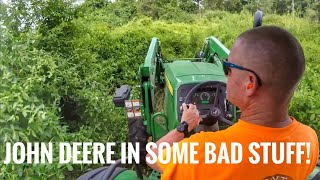 John Deere 5075E Bushhogging-brushhogging an overgrown lot with 3-4
