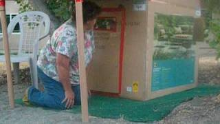 Grandma & Tyler Building Cardboard Box Playhouse