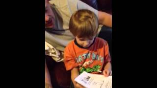 5 Year old boy reading a book (Autism)