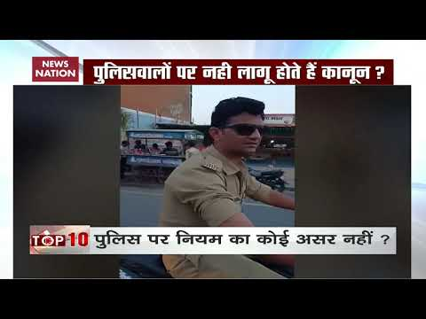 Watch: Policeman Riding Bike Without Helmet In Ahmedabad