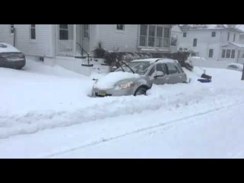 Suzuki sx4 digging it self out of snow.