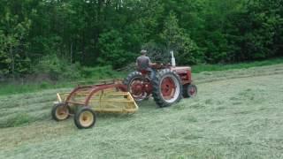 Farmall H Raking Hay