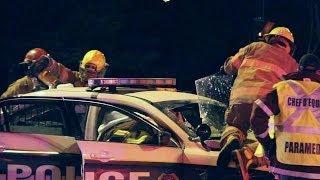 Firemen use jaws on cop car - Accident police désincarcération - Longueuil 2/24/2014