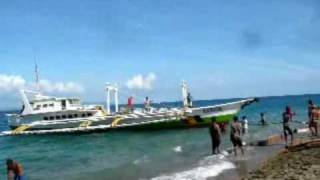 Fishing boat being launched by muscle power.wmv