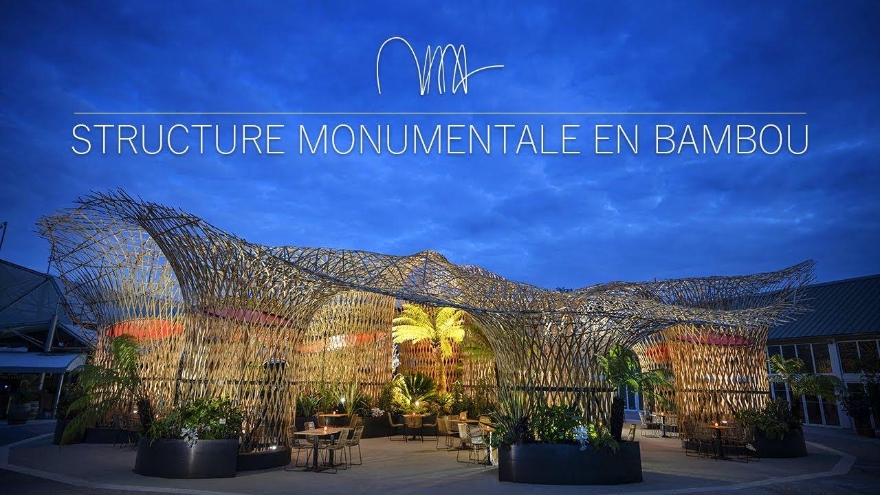 Admirez la plus grande structure en bambou d'Europe avec ses cercles de toile rouge