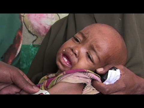 Cloaked in dust and rags, Somalis flee a looming famine