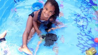 LITTLE GIRL TAKES BARBIE DOLLS SWIMMING IN THE POOL