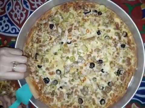صورة  طريقة عمل البيتزا طريقة عمل بيتزا الفراخ  (الدجاج) اسرار عمل بيتزا الفراخ زى المحلات طريقة عمل البيتزا بالفراخ من يوتيوب