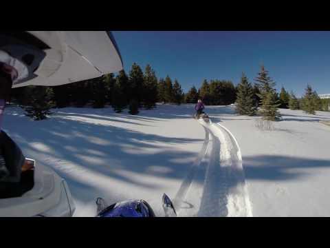 Early season snowmobiling around 9500 feet elevation
