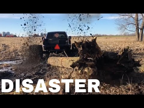 Pulling 1200lb Logs through DEEP mud with my 1500hp Duramax on 36 WIDES