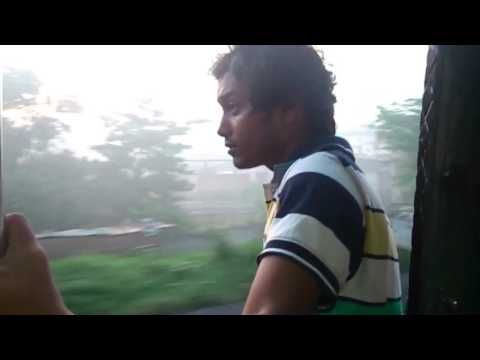 SIDE SEEN OF KOLKATA VIEW FROM A RUNNING TRAIN