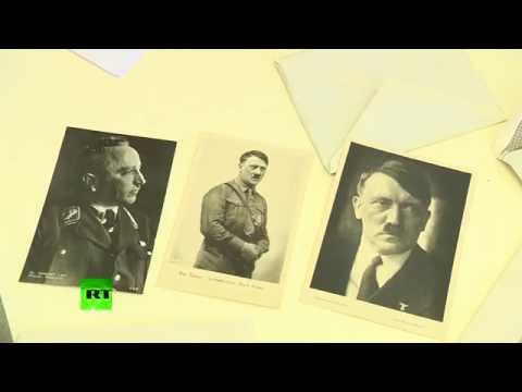 Hitler pix, Mein Kampf, badge & coins: Nazi time capsule uncovered in Poland