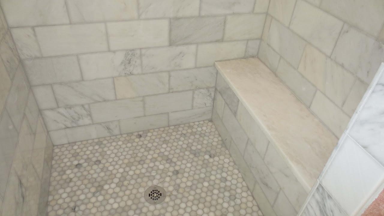 complete carrara marble tile bathroom